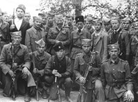 General Drazha Mihailovic with Chetniks of Srednja Bosna Corps. North of Doboy, Bosnia, Fall 1944.
