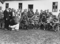 Bosnia, Oct. 1944: Col. McDowell, sitting in the middle, to the right of the Mihailovic.