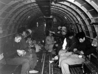 Halyard Mission, night of 27. Aug. 1944, Pranjani, Cacak, Serbia: Rescued American Airmen fastening on safety belts in preparation for evacuatin.
