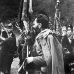 Ba Village, Serbia, January of 1944: Yugoslav Army Supreme Command Chief of Staff, Minister of Army, Navy and Air Force of Kingdom of Yugoslavia – General Dragoljub Mihailovic, kisses the Flag from World War I taken from Museum at Oplenac.